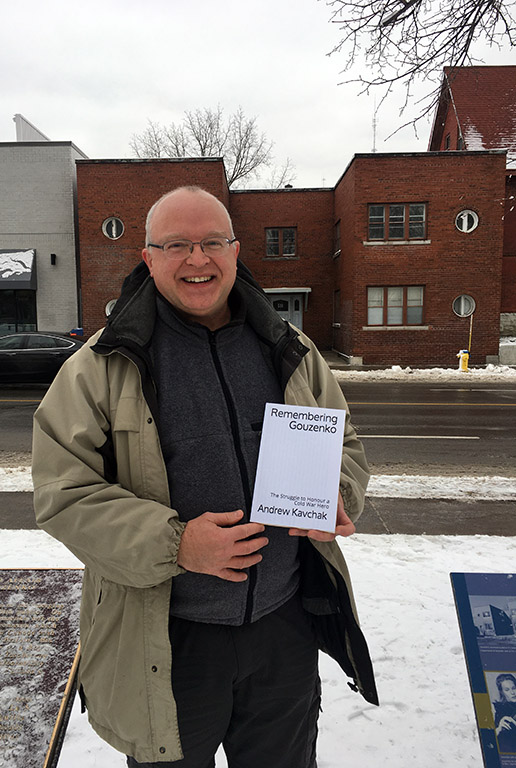 Andrew Kavchak holding his newly published book at 511 Somerset Street West, Ottawa